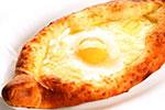 Хачапури По-аджарски (с сыром и яйцом)